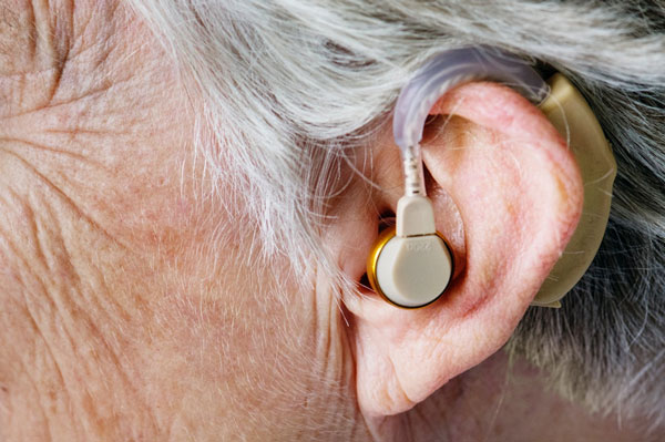 old person wearing hearing aid