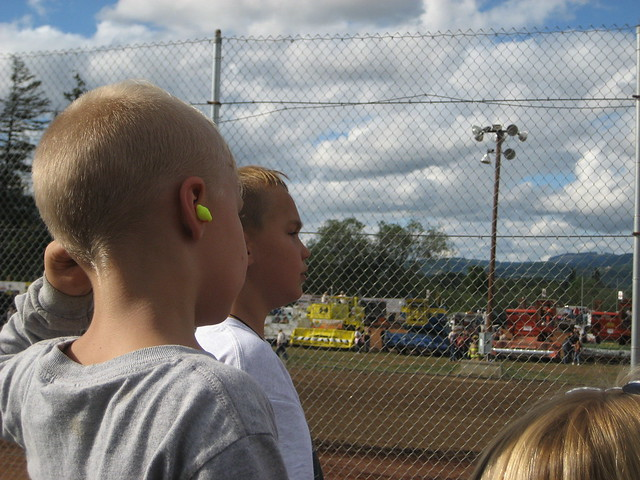 child wearing neon earplugs